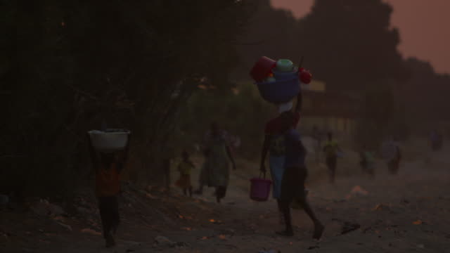 woman and child walk with baskets on head - basket stock videos & royalty-free footage