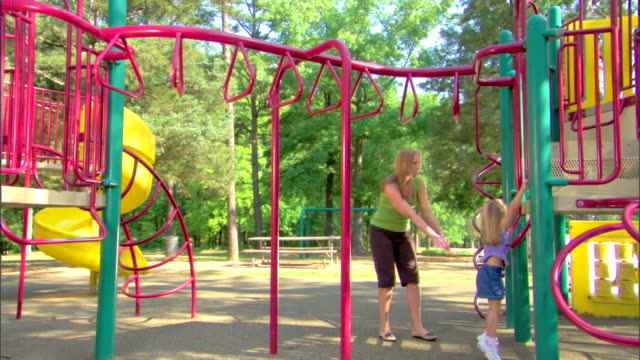 woman and girl at a playground - see other clips from this shoot 1428 stock videos & royalty-free footage