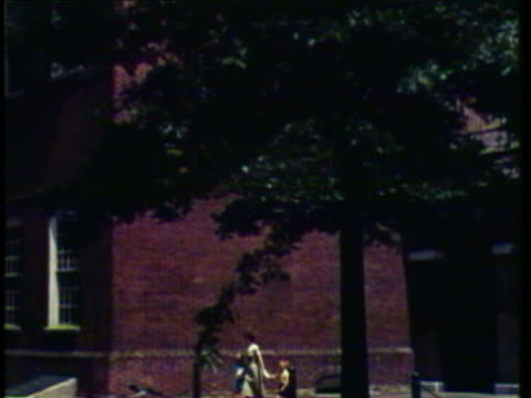 1953 ws tu woman and her children walking outside independence hall / philadelphia, pennsylvania, usa / audio - independence hall stock videos and b-roll footage