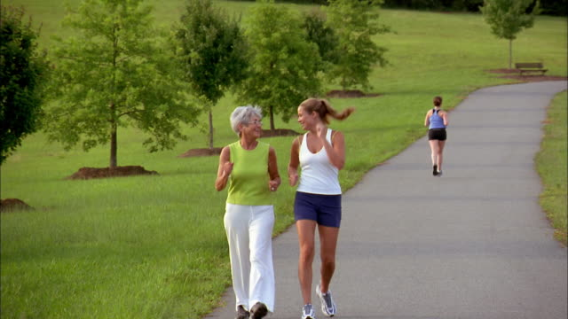 a woman and her mother race-walk together. - racewalking stock videos and b-roll footage