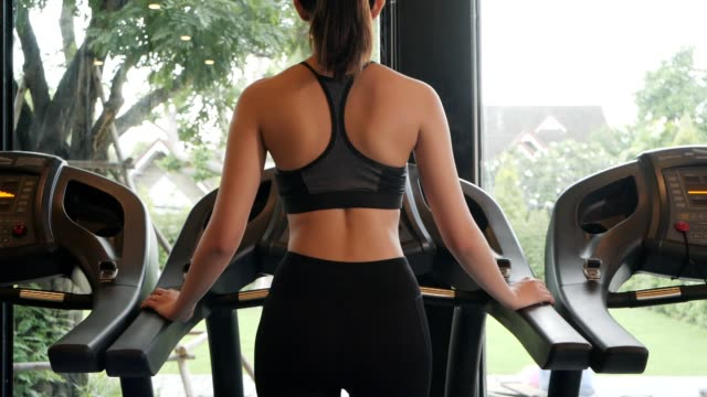 woman and man athetic walking on treadmill in fitness.healthly,exercise,city lift style concept.slow motion footage. - muscular contraction stock videos and b-roll footage