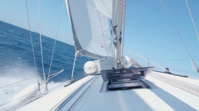 a woman and man cranking a winch with a handle while sailing a sailboat. - sailing boat stock videos & royalty-free footage