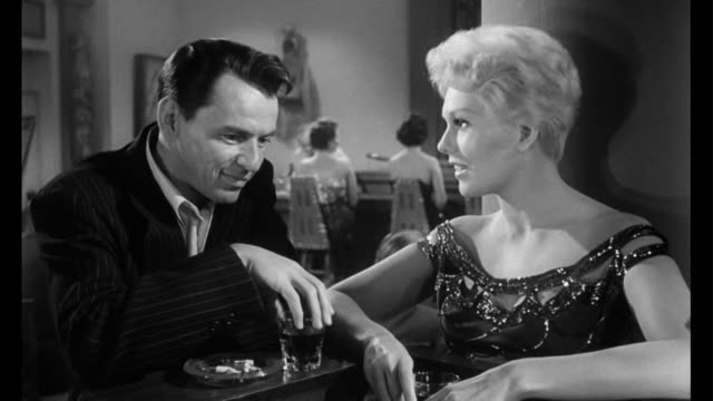 1955 woman (kim novak) and man (frank sinatra) discuss his music business aspirations - jazz video stock e b–roll