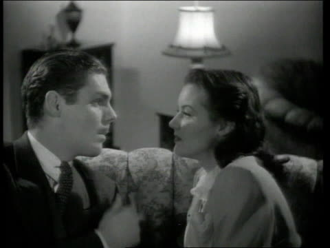 1942 ms woman and man exhale cigarette smoke into each other's faces while sitting on couch - 1942 stock videos & royalty-free footage