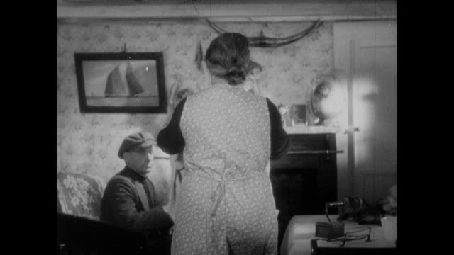 zi woman and man folding laundry together and talking / cornwall, england, united kingdom - 1937 stock videos and b-roll footage