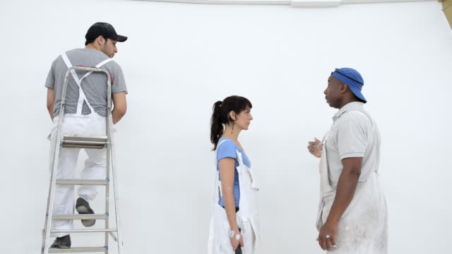 ms woman and man painting wall and man giving instructions / london, england, united kingdom - instructions stock videos and b-roll footage