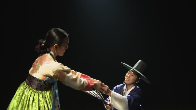 MS Woman and man performing traditional duet dance / Seoul, South Korea