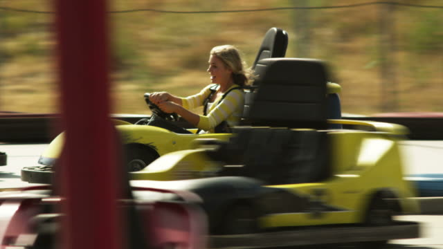 ms woman and man riding go-carts, orem, utah, usa - orem utah stock videos & royalty-free footage
