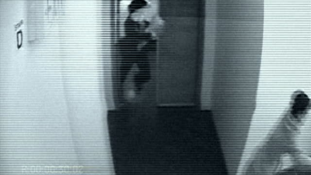 B/W HA POV woman and man running from room followed by alien / alien shooting laser gun at people / Brooklyn, New York City