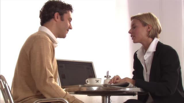 woman and man talking during business meeting in cafe - abbigliamento da lavoro formale video stock e b–roll