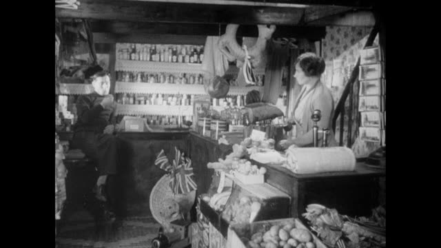 b/w woman and man talking in shop while woman fills small bags with grain / cornwall, england, united kingdom - cornwall england stock videos & royalty-free footage