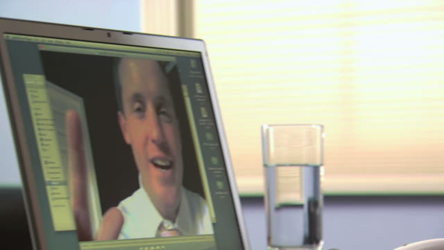 woman and man video conferencing - see other clips from this shoot 1159 stock videos & royalty-free footage