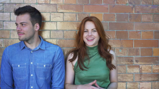 woman and man winking, pointing, looking at camera, being playful and messing about. fun, chill, mischief. - teasing stock videos & royalty-free footage