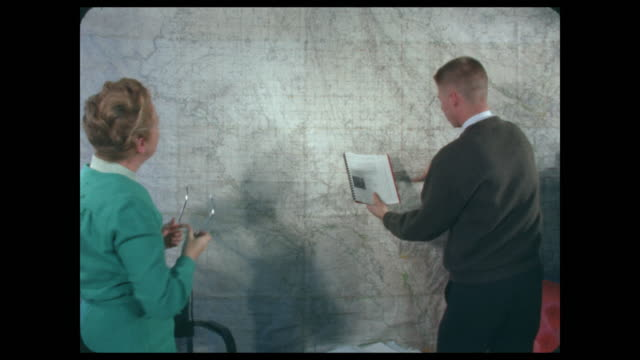 woman and man working together with maps - north america stock videos & royalty-free footage