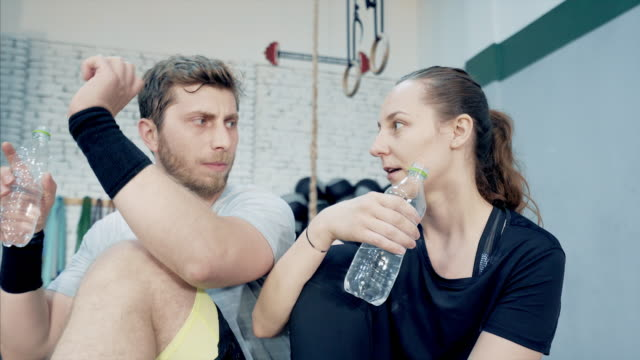 woman and men resting after an intensive workout. - resting stock videos and b-roll footage