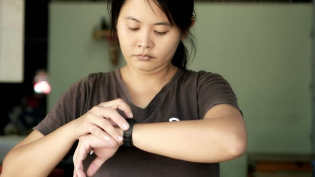woman and smart watch technology