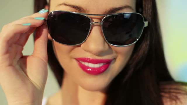 woman and sunglasses - sunglasses stock videos & royalty-free footage