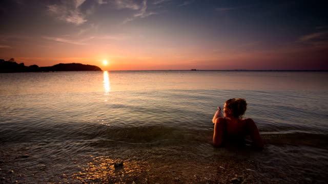 woman and sunset - ko phangan stock videos and b-roll footage