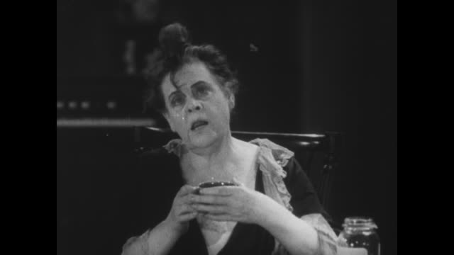 vídeos de stock, filmes e b-roll de 1929 a woman and the reverend are drunk on peach brandy - 1920 1929