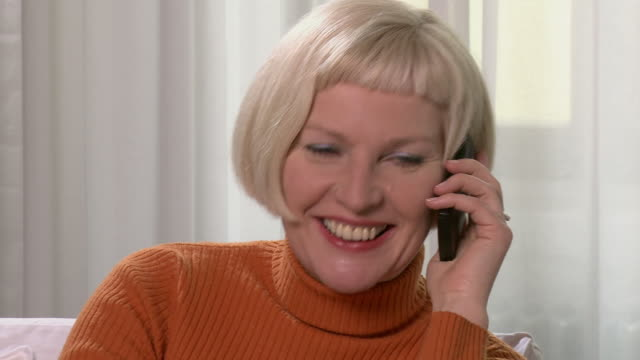 cu woman answering cell phone/ berlin, germany - polo neck stock videos & royalty-free footage