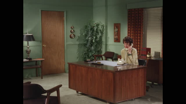 woman answering phone in mid-century office - file clerk stock videos & royalty-free footage