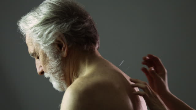slo mo ms td woman applying acupuncture needles into men's back in studio / new york city, new york state, usa - acupuncture stock videos and b-roll footage