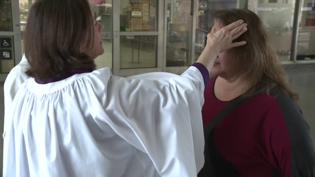 KSWB Woman Applying Ash on Foreheads on Ash Wednesday