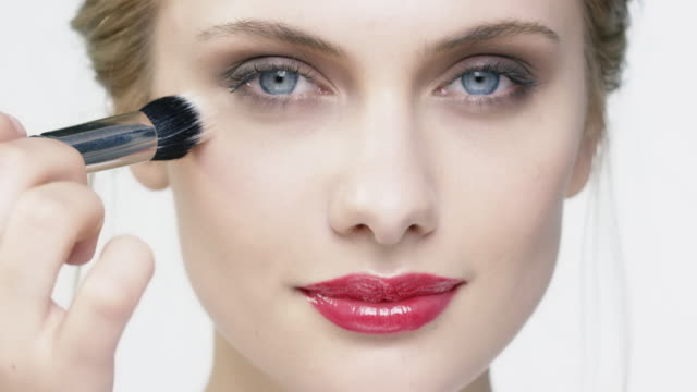 woman applying cosmetic with make-up brush - blusher make up stock videos and b-roll footage
