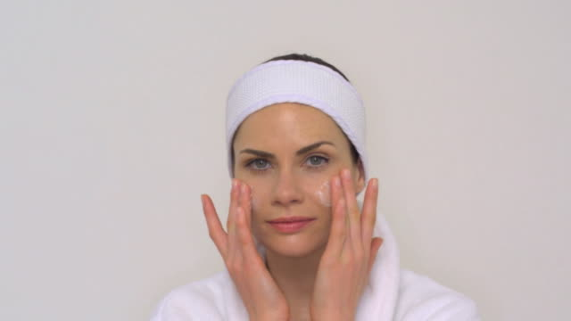 cu slo mo woman applying cream on face / london, greater london, united kingdom - face cream stock videos and b-roll footage