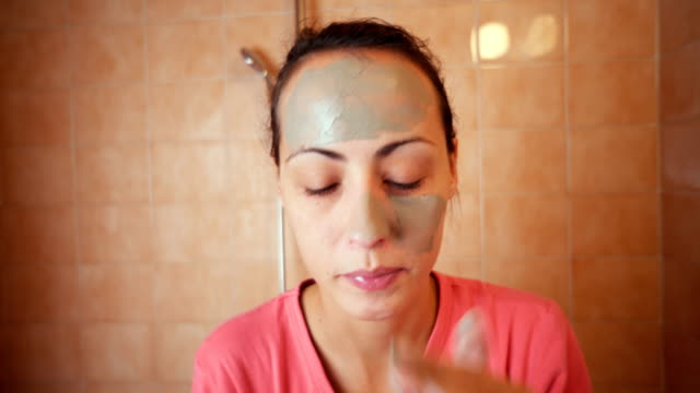 woman applying facial mask - facial mask beauty product stock videos and b-roll footage