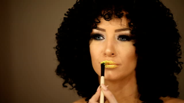 woman applying gold lipstick - funky stock videos and b-roll footage