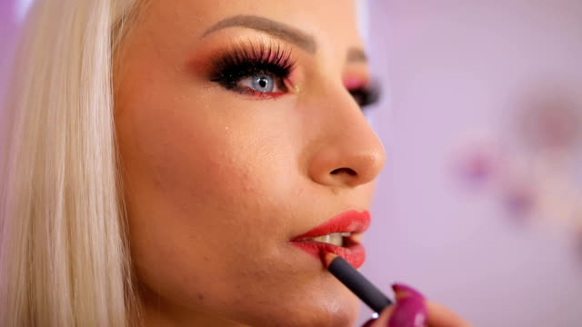 woman applying lipstick - blusher stock videos & royalty-free footage