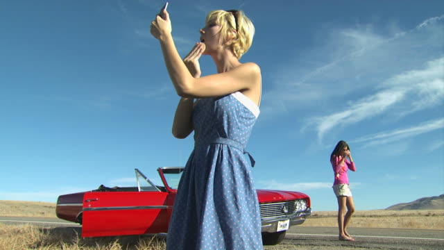 woman applying makeup along roadside - see other clips from this shoot 1138 stock videos and b-roll footage