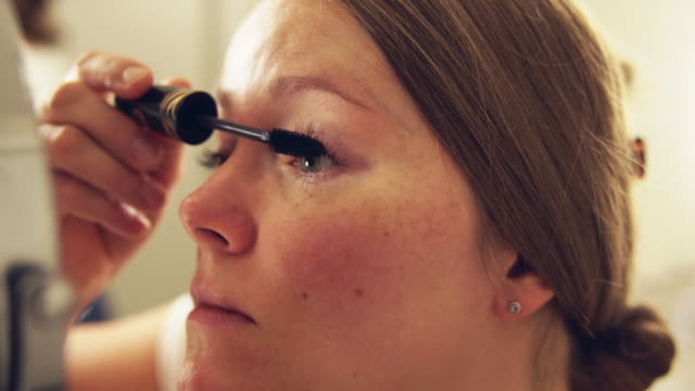 woman applying make-up at home. - cura della persona video stock e b–roll
