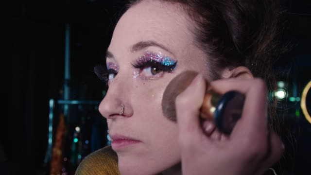 woman applying make-up - one mid adult woman only stock videos & royalty-free footage