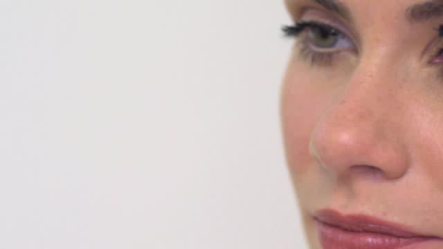 cu pan slo mo woman applying mascara / london, greater london, united kingdom - pampering self stock videos and b-roll footage