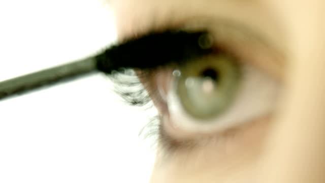 woman applying mascara on eyelashes - applying stock videos and b-roll footage