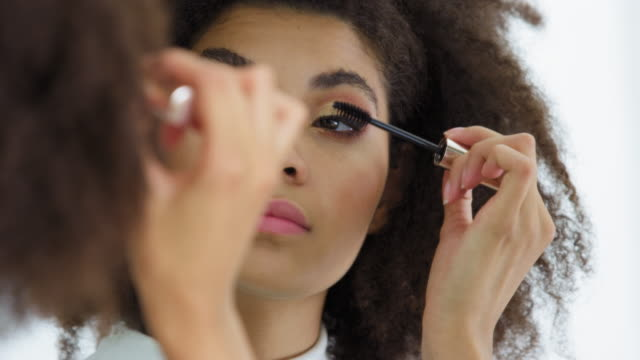 woman applying mascara - make up stock videos & royalty-free footage