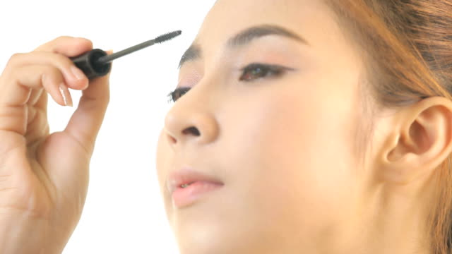 woman applying mascara - mascara stock videos & royalty-free footage