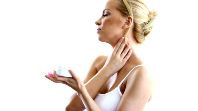 woman applying moisturizer. - neck stock videos & royalty-free footage