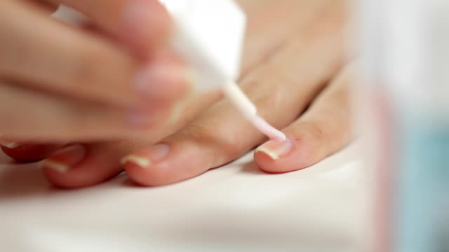 woman applying nails polish - fingernail stock videos & royalty-free footage