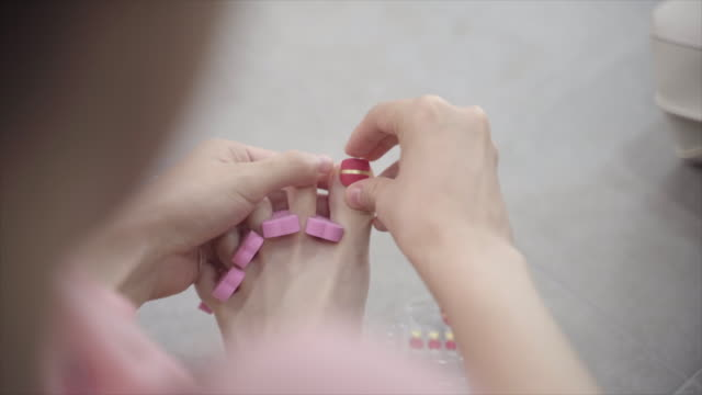woman applying pedicure on her toenails, seoul, south korea - painting toenails stock videos & royalty-free footage