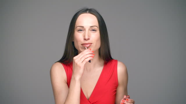 woman applying pink lipstick - pink lipstick stock videos and b-roll footage