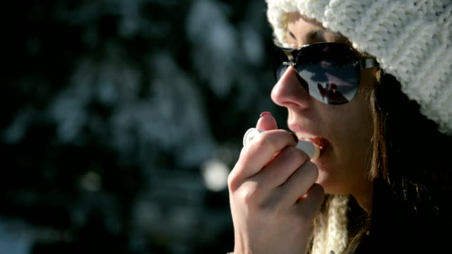 woman applying protective lip balm - dry clothes stock videos and b-roll footage