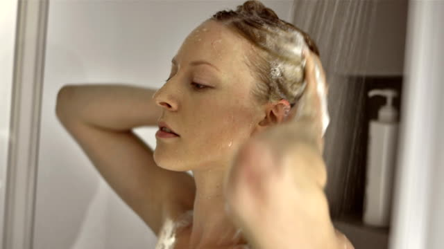 CU Woman Applying Shampoo On Hair