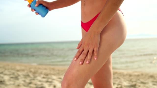woman applying sun protection cream - suntan lotion stock videos & royalty-free footage