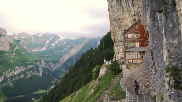 woman approaching to wooden hut in appenzell - switzerland stock videos & royalty-free footage