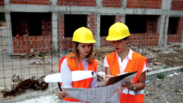 woman architect and engineer at construction site - personal organiser stock videos and b-roll footage