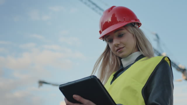 woman architect on construction site - architect stock videos & royalty-free footage