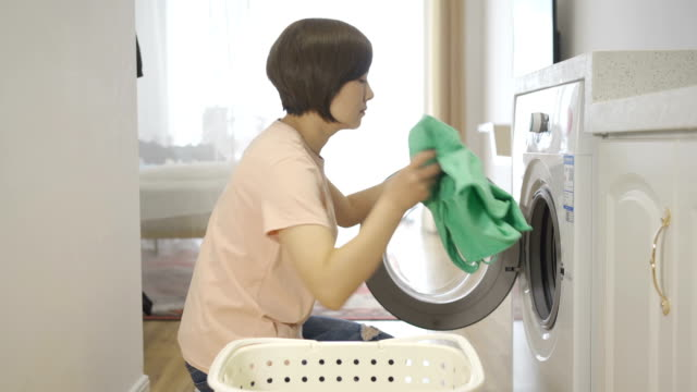 woman are using washing machines - washing stock videos & royalty-free footage